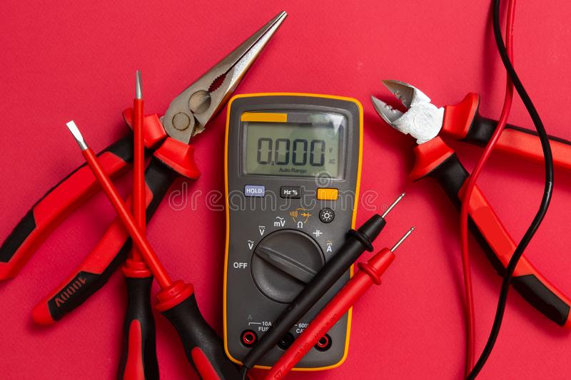 Electrician tools. Electric multimeter, screwdriver and cutters royalty free stock photos