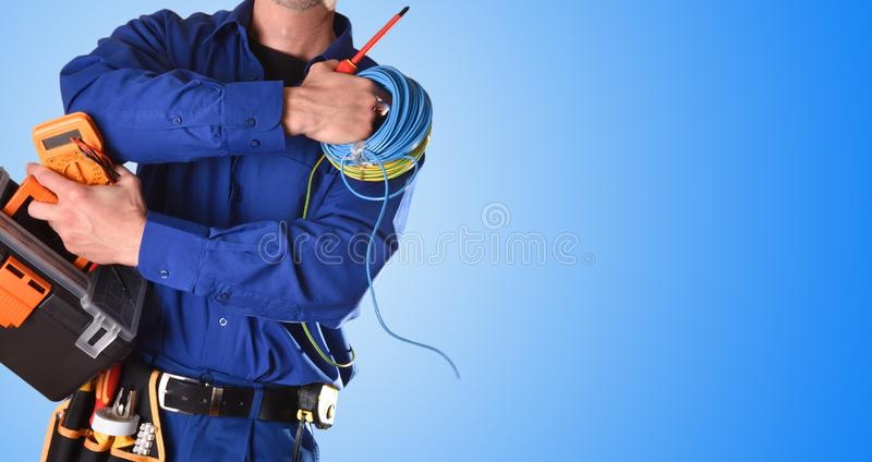 Electrician with tools and electrical equipment isolated blue detail stock image