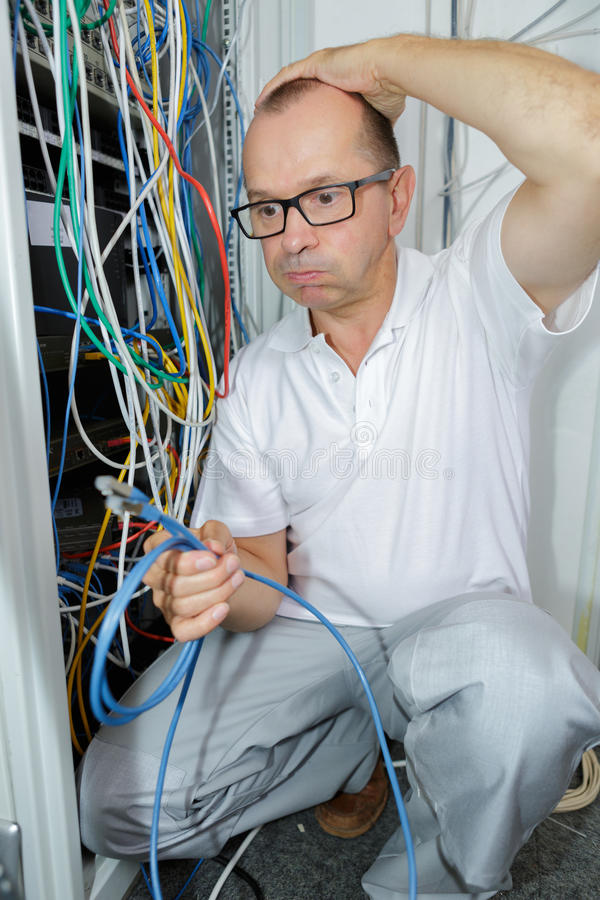Electrician trying to find right cable stock images