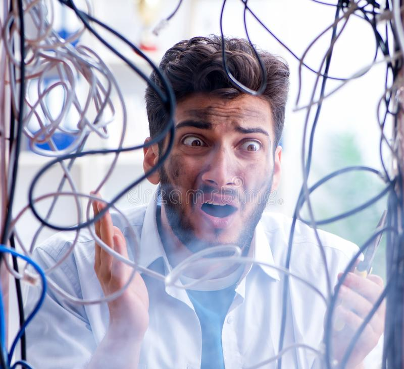 Electrician trying to untangle wires in repair concept stock images
