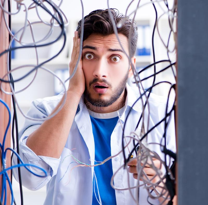 Electrician trying to untangle wires in repair concept royalty free stock image