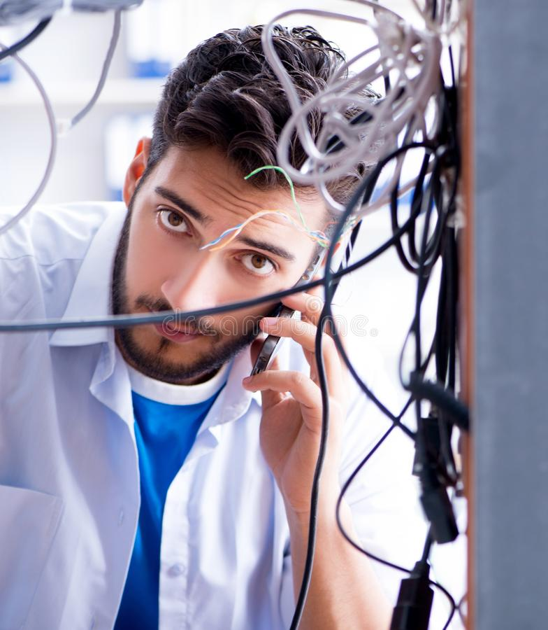Electrician trying to untangle wires in repair concept royalty free stock photography