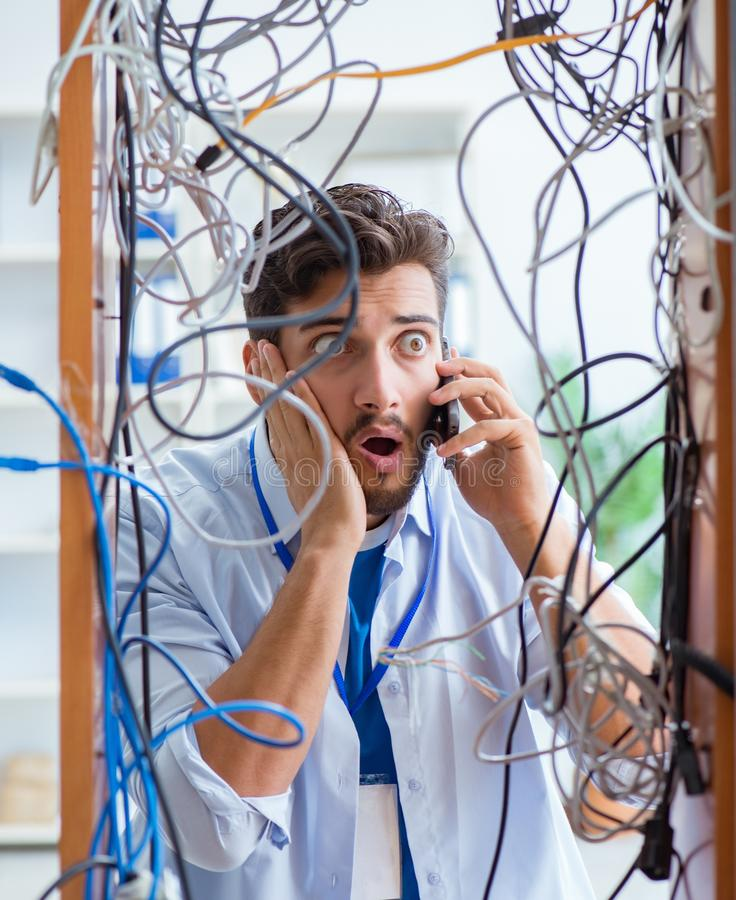 Electrician trying to untangle wires in repair concept stock photos
