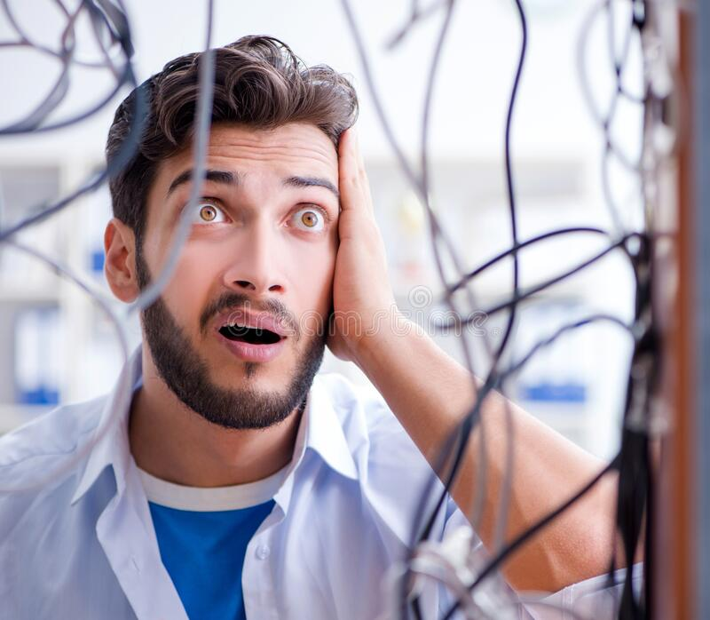 Electrician trying to untangle wires in repair concept royalty free stock photos