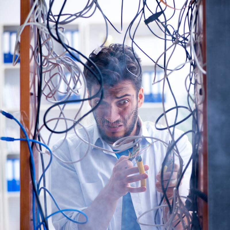Electrician trying to untangle wires in repair concept royalty free stock photo