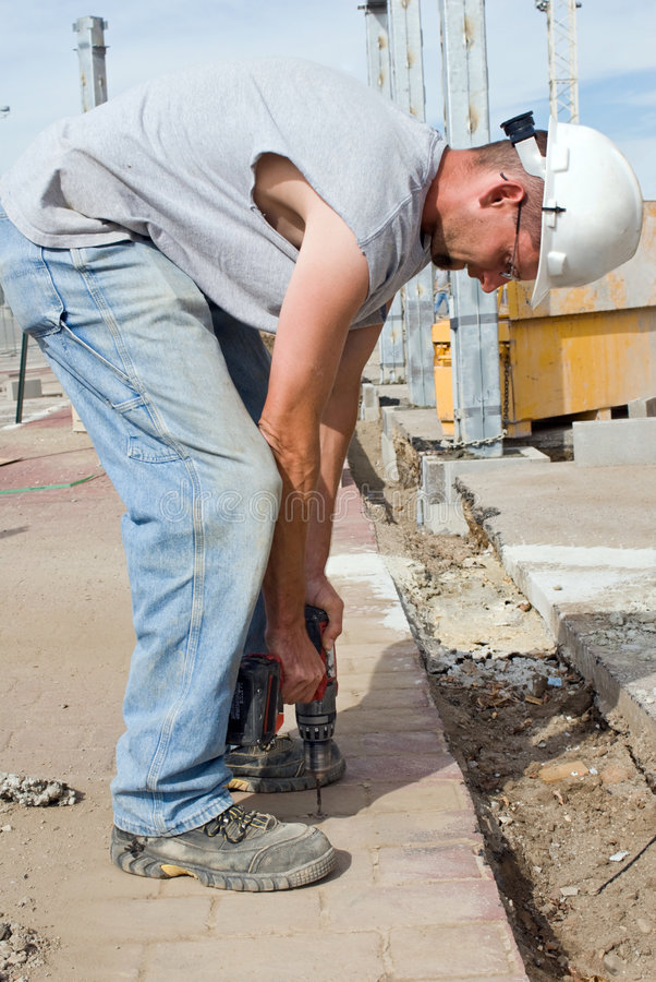 Electrician Using Drill stock images