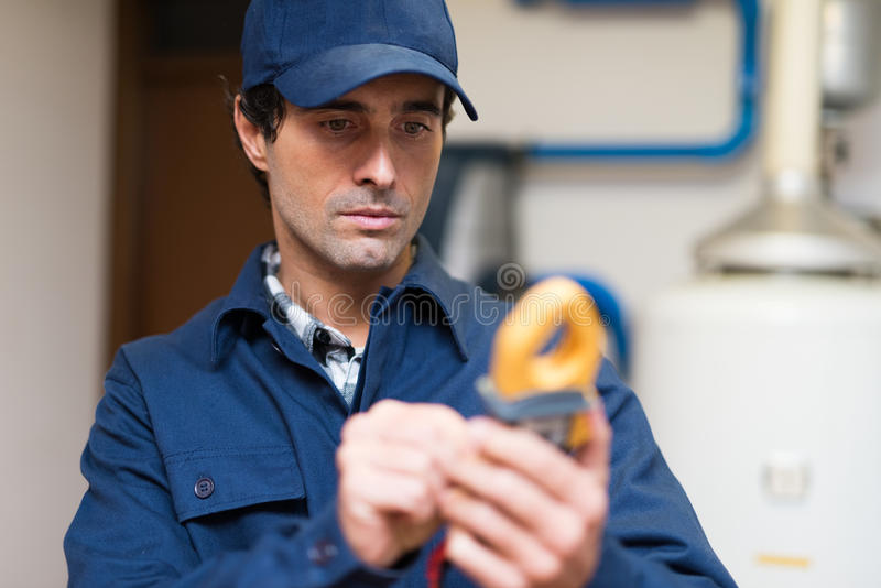 Electrician using a tester at work royalty free stock images
