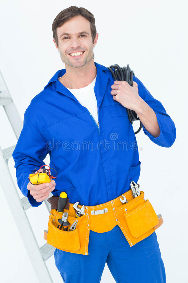 Electrician with wire roll and multimeter stock photos