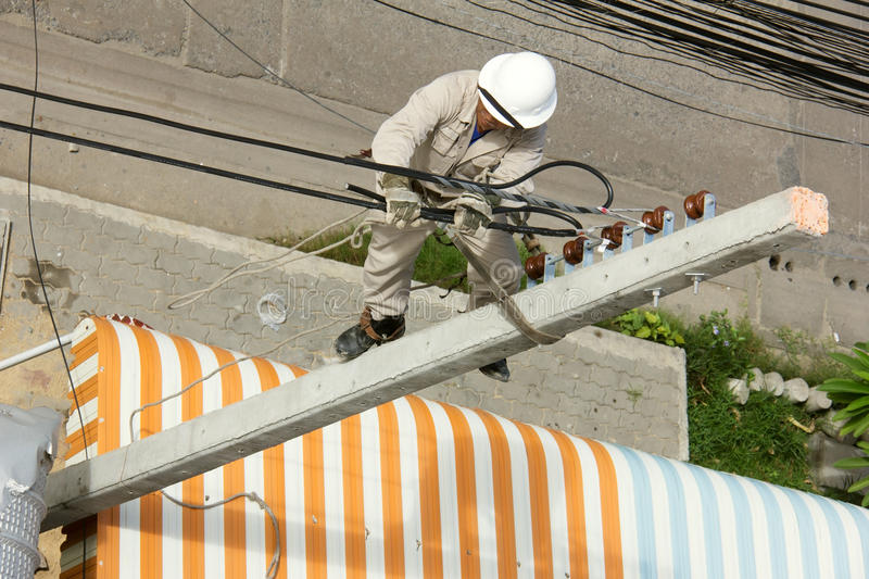 Electrician wiring on a electric pole stock image