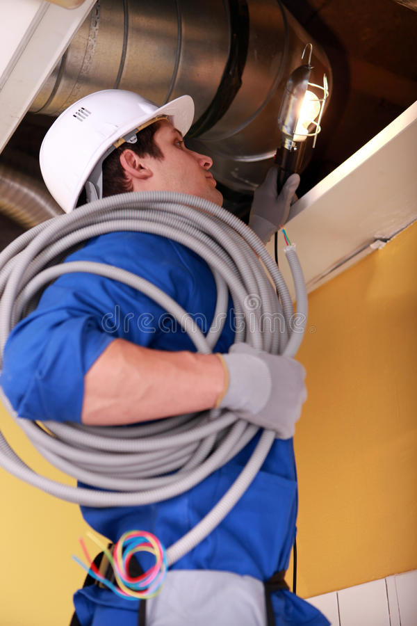 Electrician wiring loft space stock photos