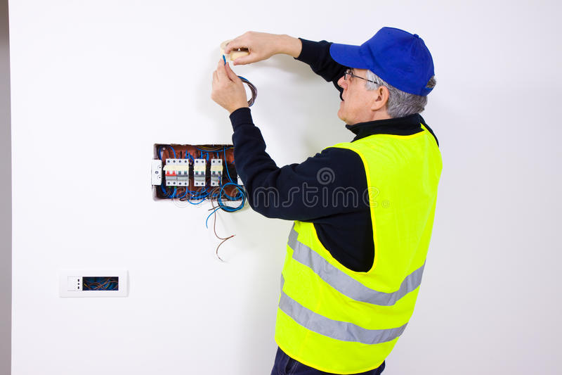Electrician at work. In a building site royalty free stock images