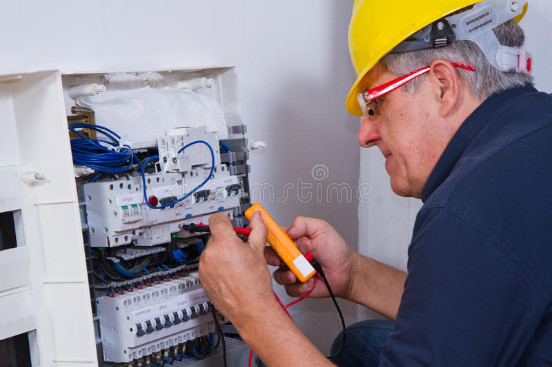 Download Electrician at work stock image. Image of labor, laborer - 68375853