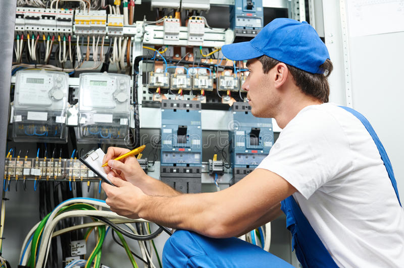 Electrician worker inspecting royalty free stock photography
