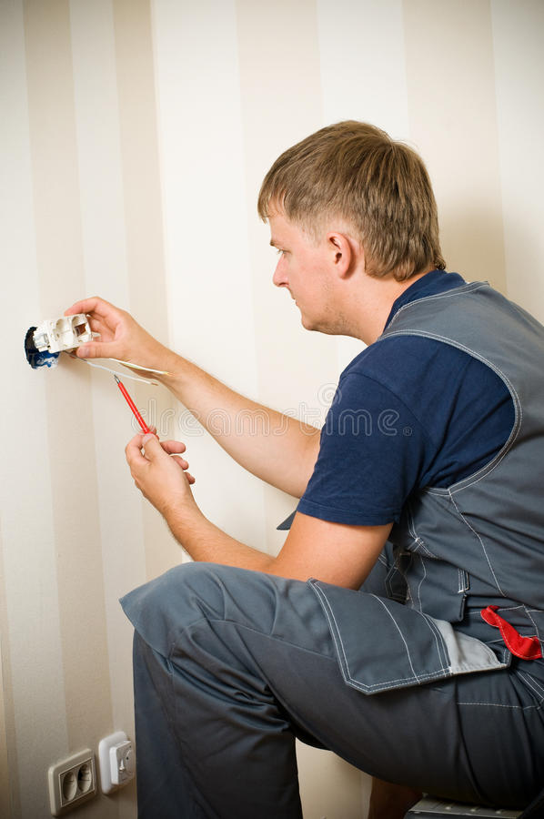Electrician working. On installing a receptacle royalty free stock images