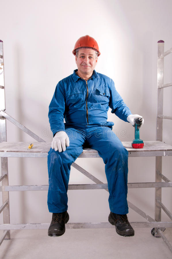 An electrician working. Senior electrician working on workplace stock photos