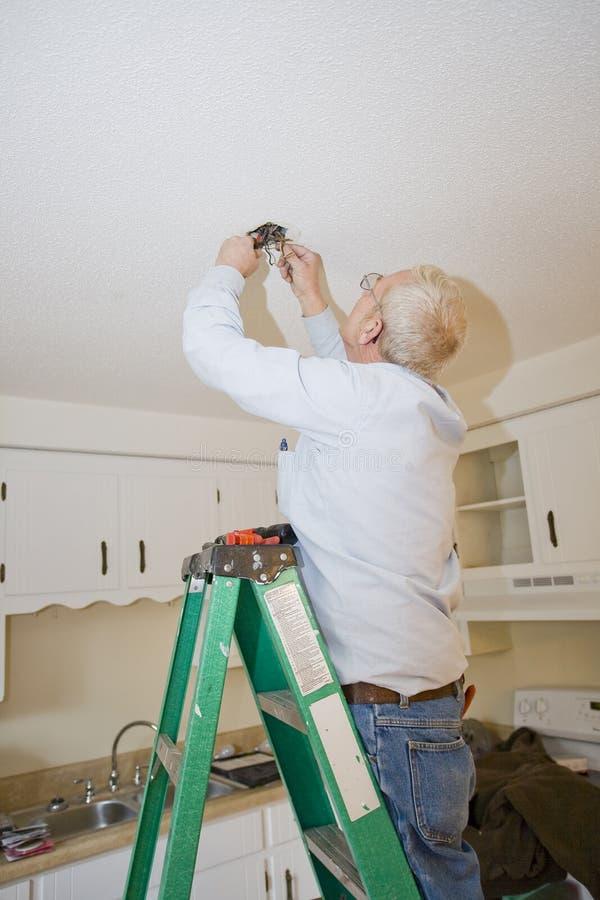 Electrician working stock photos