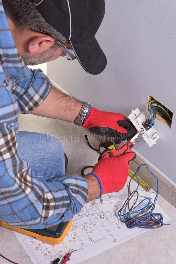 Electrician working in the electrical plant. stock photos