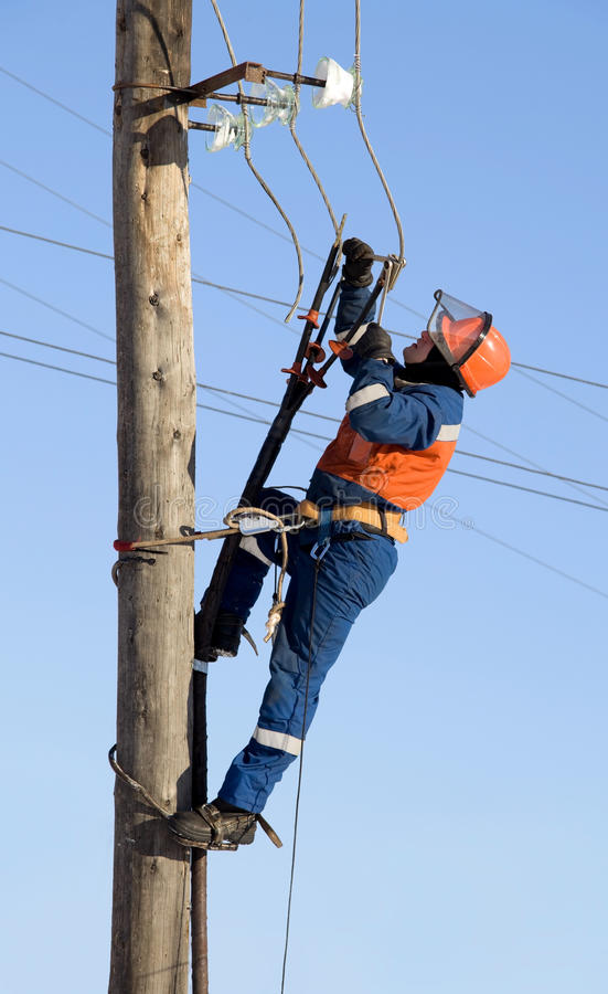 Electrician working at height royalty free stock photo