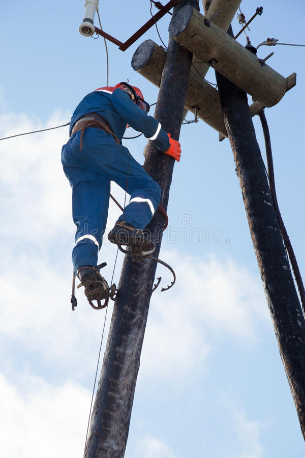 Electrician working at height stock photos