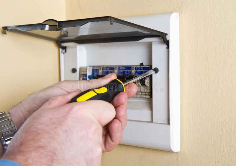 Electrician working stock images