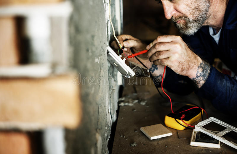 Electrician working house repair installation royalty free stock photo