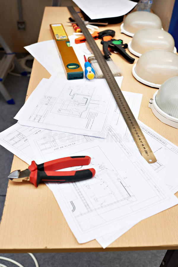 Electrician working place with drawings and tools stock photo
