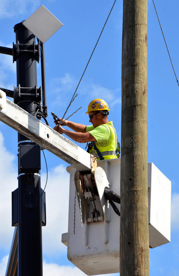 Electrician working on pole in Columbus, OH royalty free stock photo