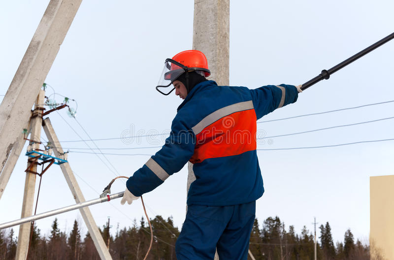 Electrician working on power lines royalty free stock images
