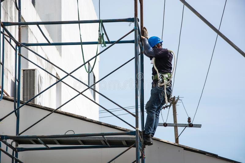 Electrician is working on scaffolding outdoor. stock photos