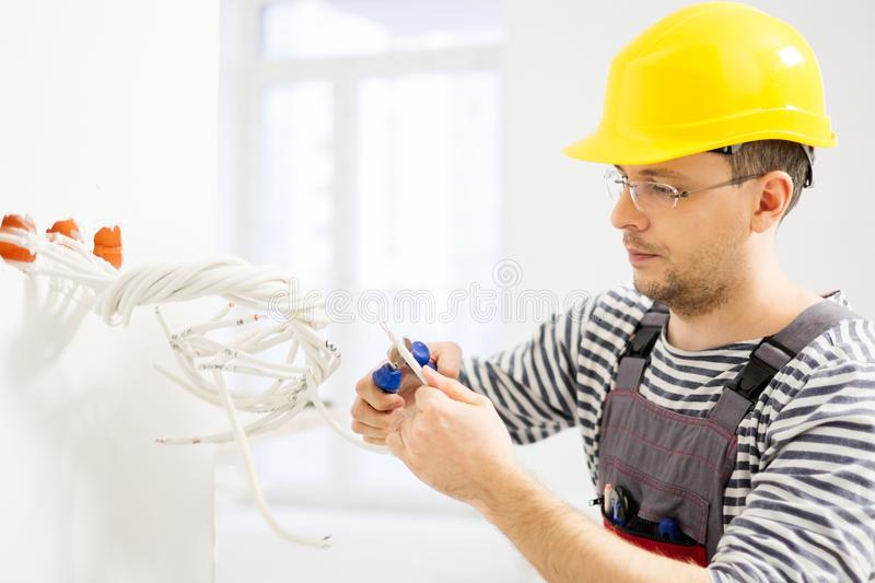 Electrician working with wires stock photos