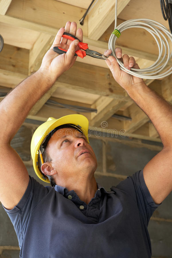 Electrician Working On Wiring. In New Home royalty free stock photography