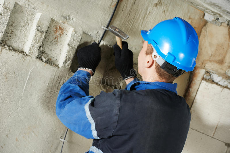 Electrician works with electric network royalty free stock photos