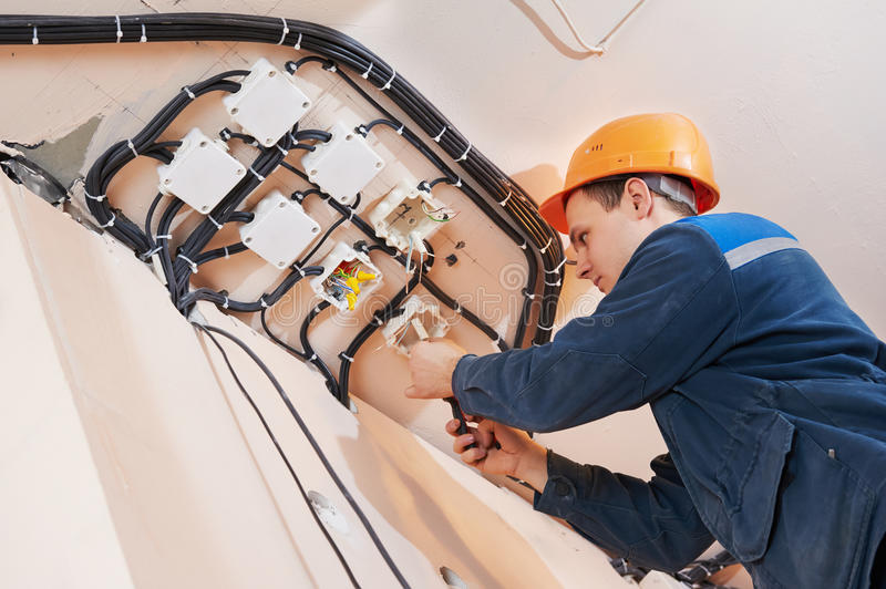 Electrician works with electric network stock photography