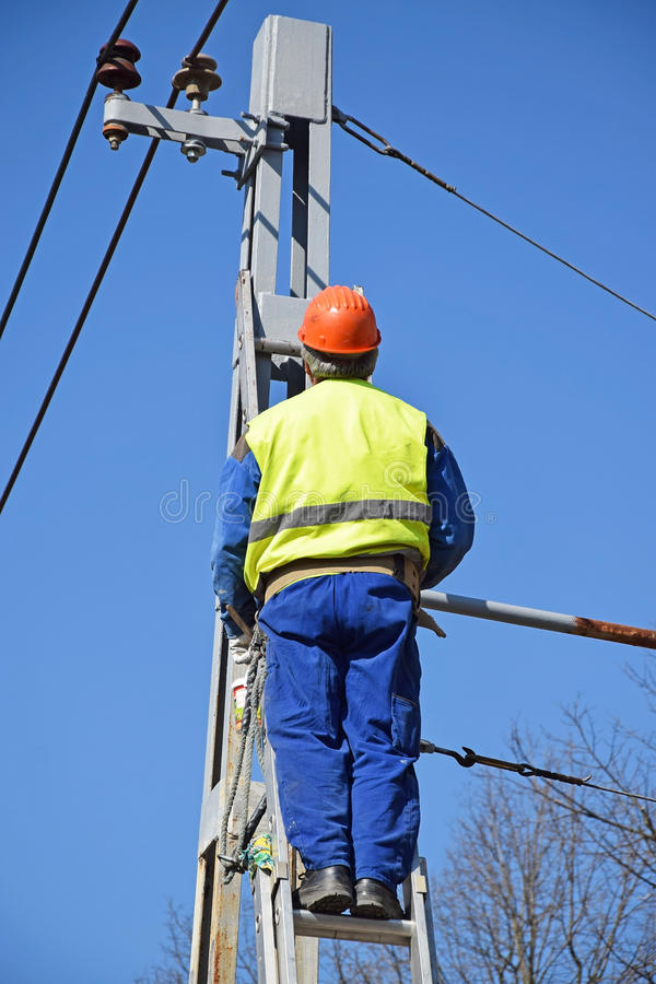 Electrician works on a pylon stock photography