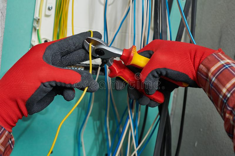 Electrician works with cable wire stock image