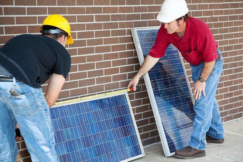 Electricians Measure Solar Panels stock image