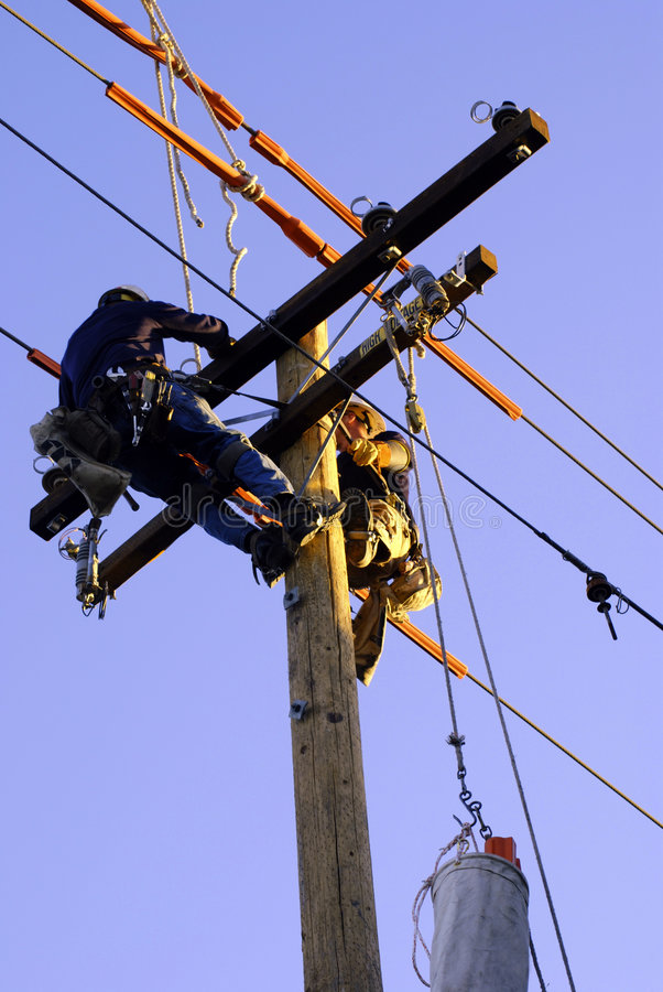 Electricians on Pole stock photography