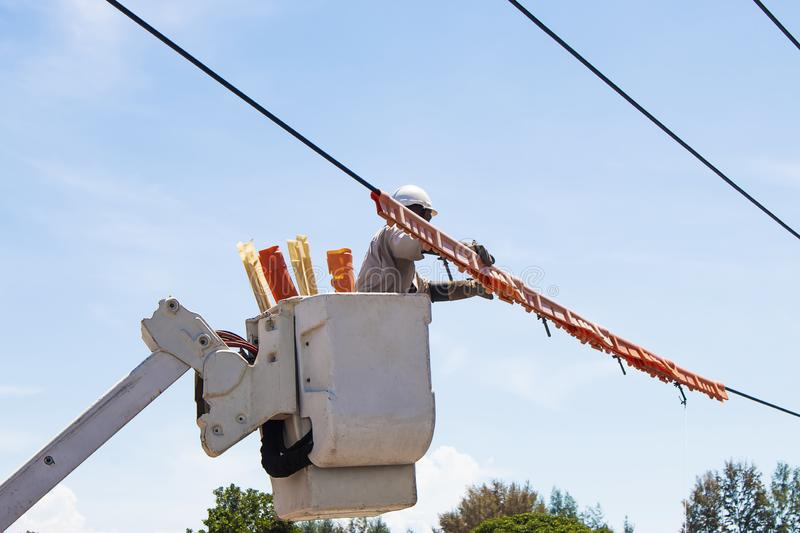 Electricians protect electrical wires at construction sites. stock images