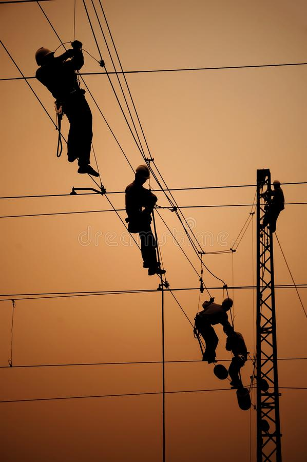 Electricians repair contact wire. On electrified railway