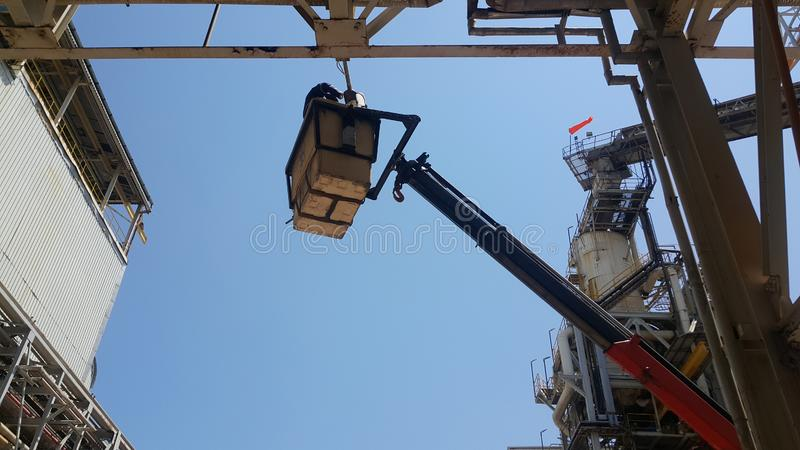 Electricians repair the power line with a lift. Sky with cloud background royalty free stock photo
