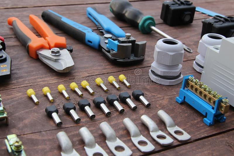 Electricians tools, machines protection neatly on wooden surface stock image