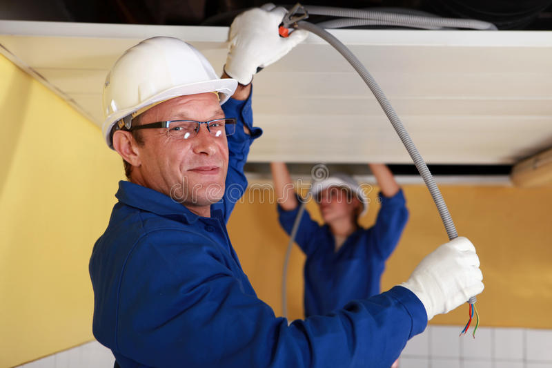 Electricians at work stock photography