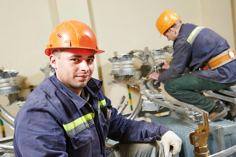 Electricians workers stock image