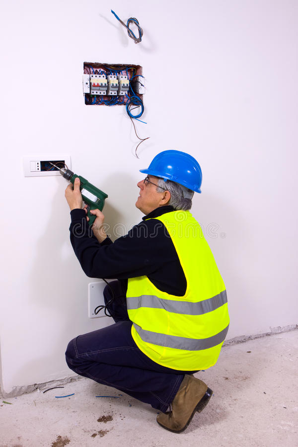 Electricina at work. Electrician at work with tools in site royalty free stock images