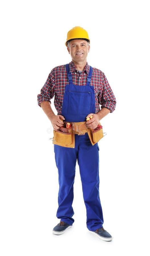 Electricista con las herramientas que llevan el uniforme imagen de archivo