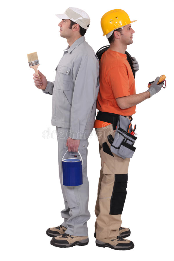 Electricista y pintor foto de archivo