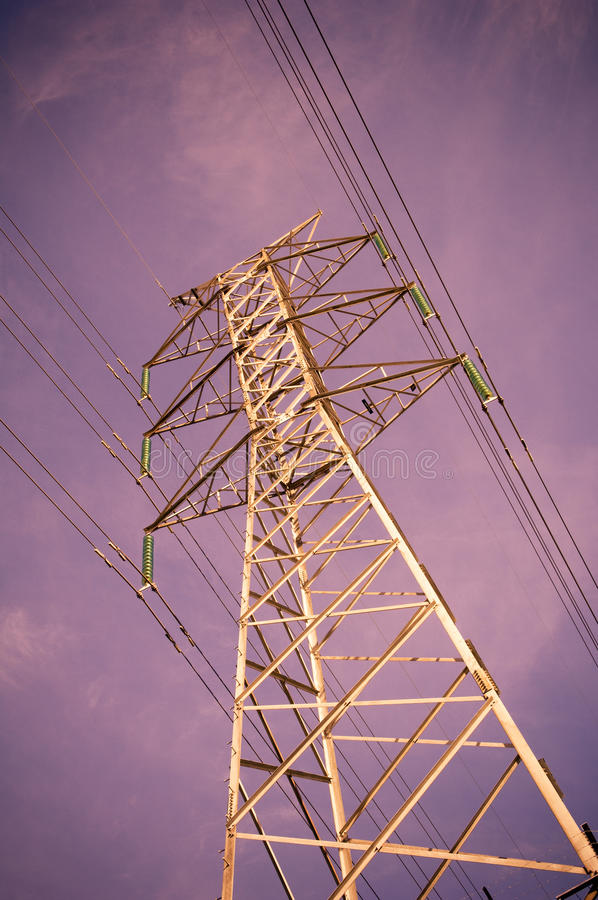 Electricity. Massive power lines stretch into the distance royalty free stock photography