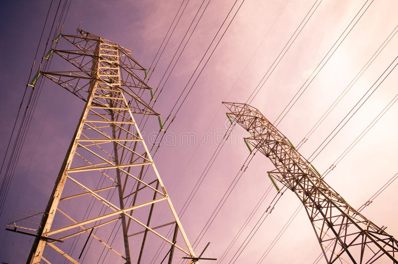 Electricity. Massive power lines stretch into the distance stock images