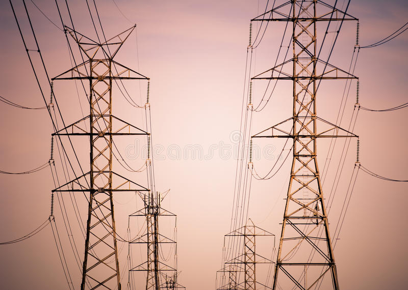 Electricity. Massive power lines stretch into the distance royalty free stock photos