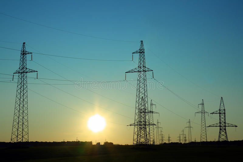 Electricity cable communication towers stock images